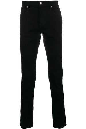 Frame Mid-rise slim-fit jeans