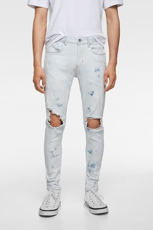 Zara Ripped skinny jeans with paint splatter