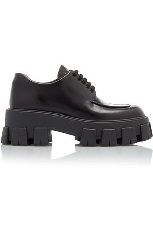 Prada Rubber-Trimmed Leather Brogues