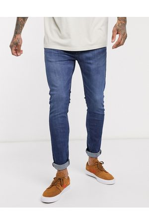 Levi's Youth 519 super skinny fit hi-ball roll jeans in myers day advanced stretch dark vintage wash