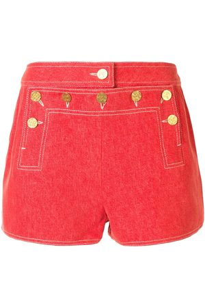 CHANEL Buttoned flap shorts