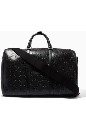 Gucci GG Embossed Duffle Bag in Leather