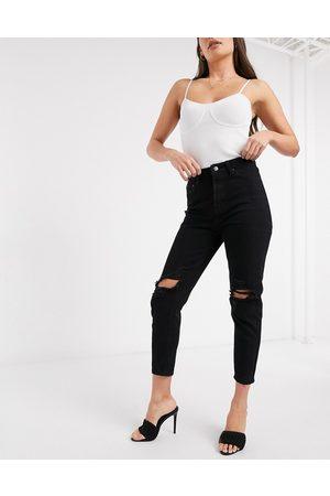 In The Style X Jac Jossa mom jeans with ripped knee in washed