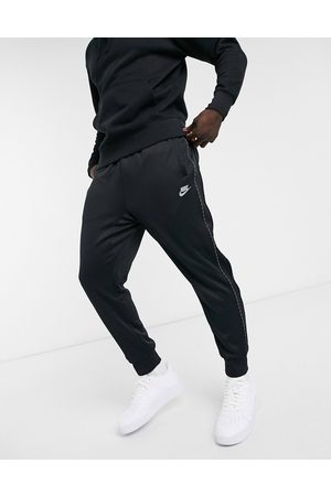 Nike Repeat Pack logo taping polyknit cuffed joggers in