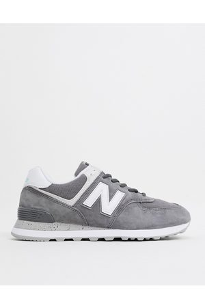 New Balance 574 trainers in suede