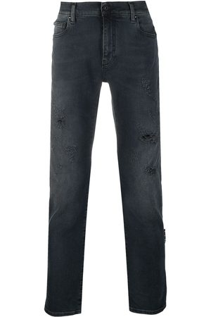OFF-WHITE Ripped detail bootcut jeans