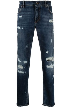 Dolce & Gabbana Embossed logo ripped slim-fit jeans