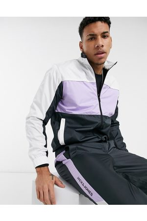 Jack & Jones Intelligence tracksuit with zip through jacket in colour block lilac