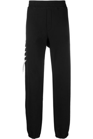 CRAIG GREEN Contrasting laced track pants