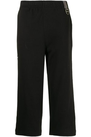 Off-Duty Sid logo-embroidered cropped trousers