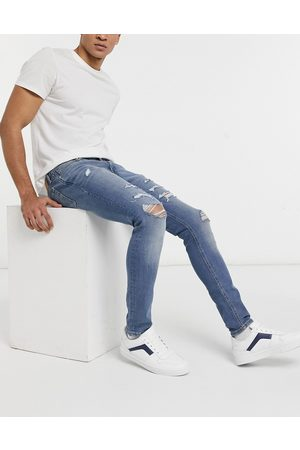 Jack & Jones Intelligence Liam skinny jeans with rips in