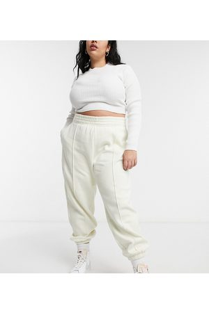 Nike Plus mini swoosh oversized jogger in off