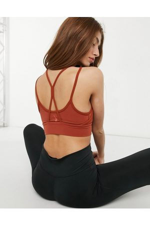 Nike Nike Yoga Indy light support layered sports bra in rust
