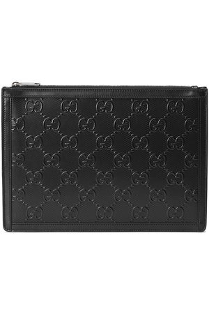 Gucci Men Wallets - GG embossed pouch