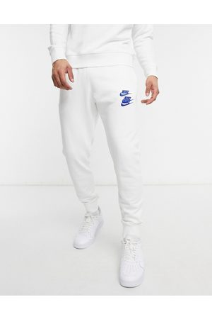 Nike Men Tracksuit - World Tour Pack graphic cuffed joggers in