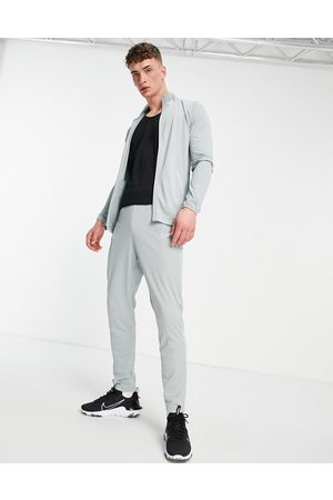 Nike Dri-FIT Academy 21 tracksuit joggers in