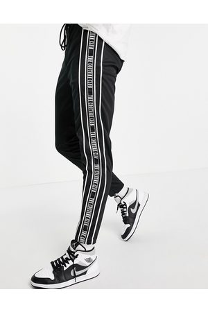 The Couture Club Taped track joggers in