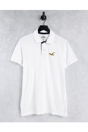 Hollister Exploded reflective icon logo slim fit pique polo in