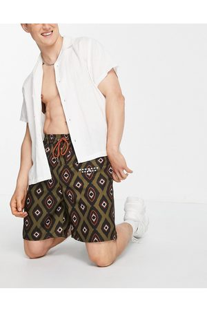 Mennace Shorts co-ord in green all over print