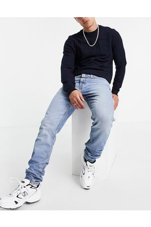Levi's Levi's 512 slim tapered fit lo-ball jeans in mid wash