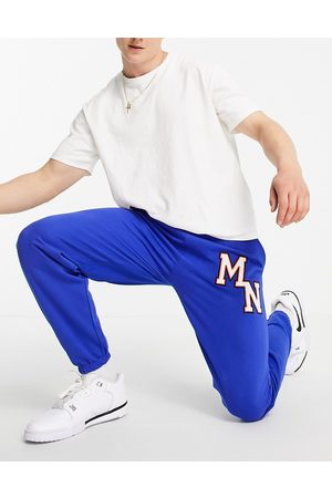 Mennace Joggers in with collegiate embroidery