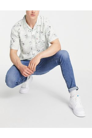 Levi's Levi's skinny tapered fit jeans in mid wash