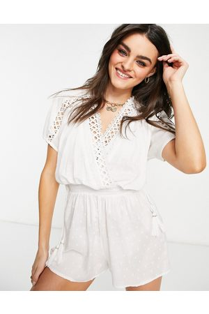 River Island Textured plunge beach playsuit in