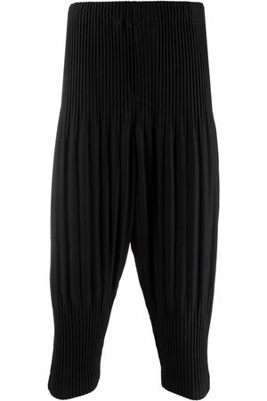 HOMME PLISSÉ ISSEY MIYAKE Pleated tapered-leg trousers