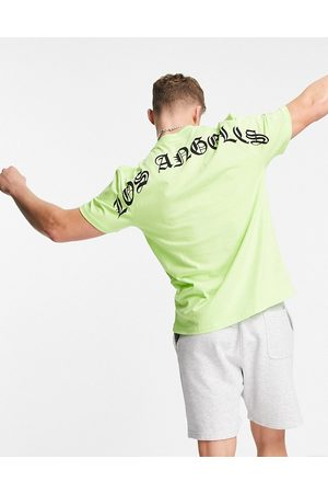 River Island T-shirt with LA back print in neon