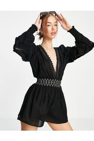River Island Lace volume sleeved beach playsuit in