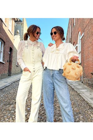 Labelrail X Collyer Twins relaxed dungarees with broderie trim