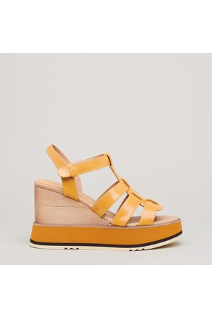 Paloma Barcelo Leather sandal with wedge 90 in leather and micro rubber