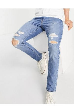 Levi's Levi's 512 slim tapered fit distressed jeans in mid wash
