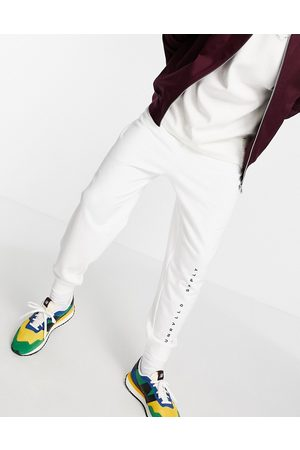 ASOS Men Tracksuit - Relaxed joggers with logo print in