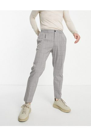 Topman Taper pupstooth check trousers
