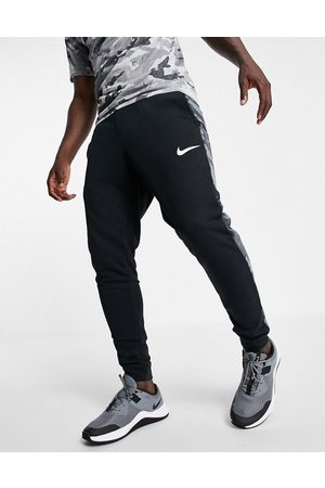 Nike Camo tapered joggers in