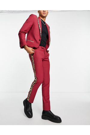 Twisted Tailor Suit trousers in red with leopard print side stripe