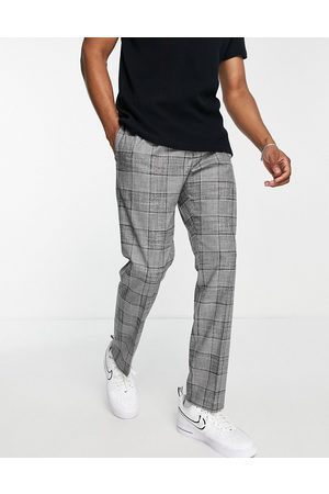 River Island Pleated slim check suit trousers in