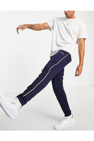 Reebok Classics logo joggers with piping in
