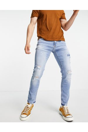 River Island Skinny jeans with rips in light